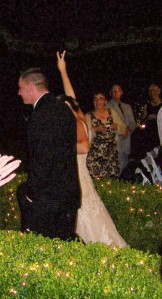 Kristi flashing the 3 down the aisle